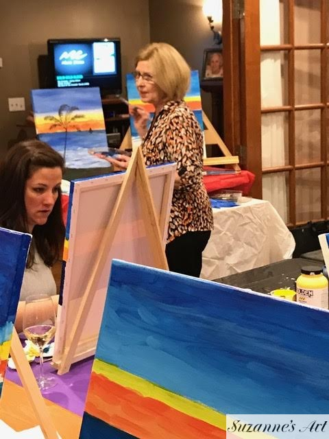 Suzanne Foxwell presenting at a painting party